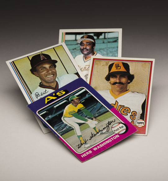 Some of Doug McWilliams' favorite images on Topps card include (clockwise from top center) Joe Morgan's 1982 card, Rollie Fingers 1981 card, Herb Washington's 1975 card and Bert Campaneris' 1982 card. (Topps baseball cards photographed by Milo Stewart Jr./National Baseball Hall of Fame and Museum)