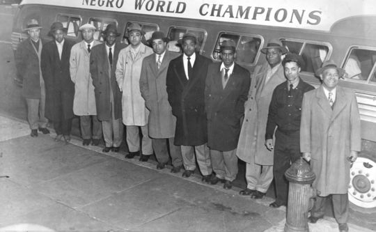 Members of the Newark Eagles stand outside a bus commemorating their 1946 Negro World Series championship. BL-98-2008-4 (Larry Hogan / National Baseball Hall of Fame Library)