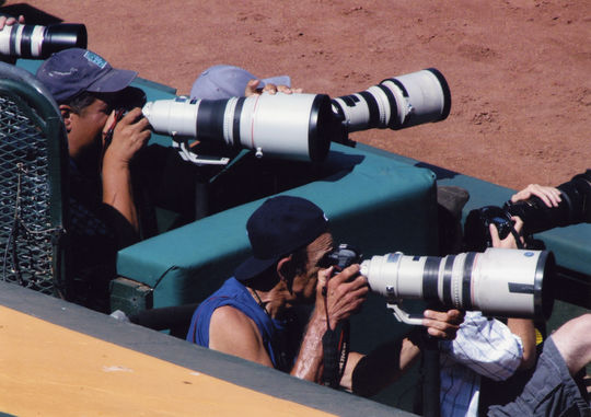 Photographers are responsible for capturing all types of baseball moments. Pictured here are baseball photographers Brad Mangin and Michael Zargaris in the photo pit at Oakland in 2012. (Doug McWilliams/National Baseball Hall of Fame and Museum)