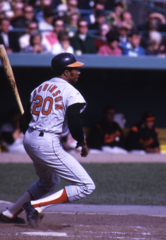 Traded to the Orioles prior to the 1966 season, Frank Robinson led Baltimore to the World Series title that year and became the first player to win MVP awards in both leagues following a season where he won the AL Triple Crown. (National Baseball Hall of Fame and Museum)