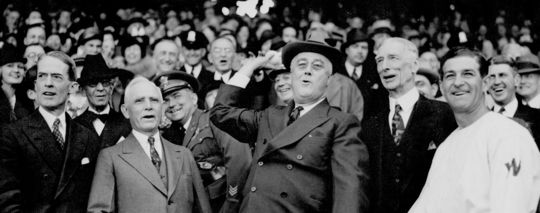 President Franklin Roosevelt throws out the first pitch on Opening Day 1937, at Griffith Stadium in Washington D.C. To his left is Hall of Famer Clark Griffith, the owner of the Washington Senators, and to his right are fellow Hall of Famers Connie Mack, and Bucky Harris. (National Baseball Hall of Fame and Museum)