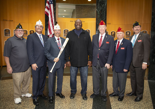 Hall of Famer Lee Smith poses with members of the American Legion during a March 29, 2019, event celebrating the Legion's 100th birthday. (Milo Stewart Jr./National Baseball Hall of Fame and Museum)