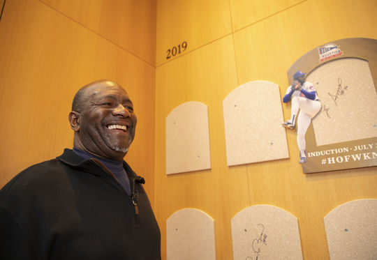 Lee Smith, in Cooperstown for his Orientation Visit, smiles after signing the backing where his Hall of Fame plaque will reside. (Milo Stewart Jr./National Baseball Hall of Fame and Museum)