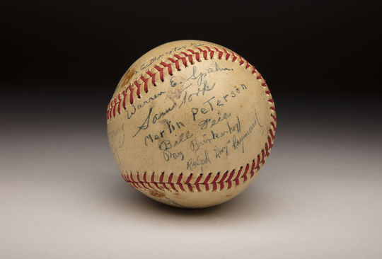 Warren Spahn signed this baseball, along with other members of the U.S. Army's 115th Engineering Group, in the waning days of World War II. (Milo Stewart Jr./National Baseball Hall of Fame and Museum)