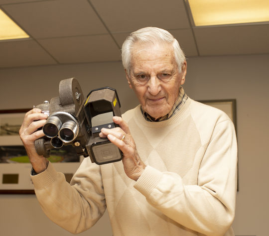 The camera David Marlin donated to the National Baseball Hall of Fame and Museum, pictured in Marlins hands above, was used to capture Ted Williams' home run in his final big league plate appearance. (Milo Stewart Jr./National Baseball Hall of Fame and Museum)