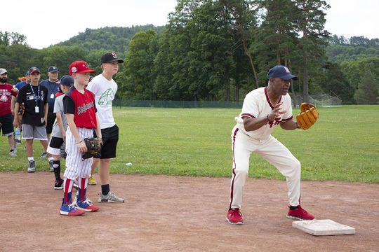 Hall of Famer Ozzie Smith works with participants during PLAY Ball on Friday morning of Hall of Fame Weekend 2019. (Milo Stewart Jr./National Baseball Hall of Fame and Museum)