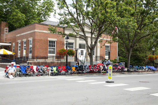 Fans line up on Main Street on Friday in anticipation of Saturday's Parade of Legends in Cooperstown. (Milo Stewart Jr./National Baseball Hall of Fame and Museum)