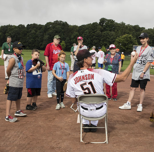 Hall of Famer Randy Johnson gives some pitching pointers to Museum supporters at the 2017 <em>PLAY Ball</em> event in Cooperstown. (By Photographer Milo Stewart Jr./National Baseball Hall of Fame and Museum)