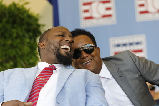 Class of 2018 Inductee Vladimir Guerrero shares a laugh with former teammate and fellow Hall of Famer Pedro Martinez. (Milo Stewart Jr./National Baseball Hall of Fame and Museum)