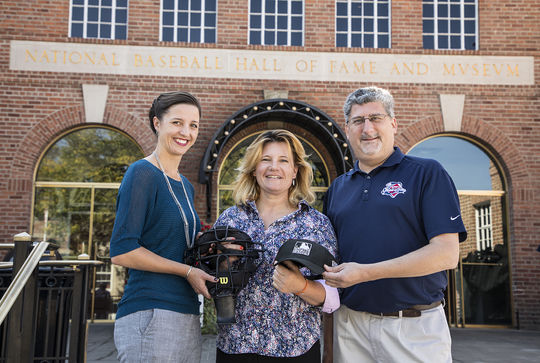 Jen Pawol (center) poses with assistant curator Gabrielle Augustine (left) and vice president, exhibitions & collections Erik Strohl outside of the Hall of Fame with her recently donated artifacts. (By Photographer Milo Stewart Jr./National Baseball Hall of Fame and Museum)