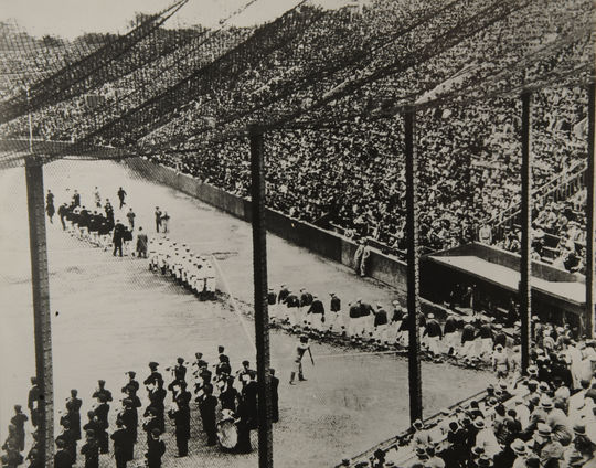 The American and Japanese teams parade on the field during opening ceremonies at Meiji Jingu Stadium. – B-277-51-24 (National Baseball Hall of Fame Library)